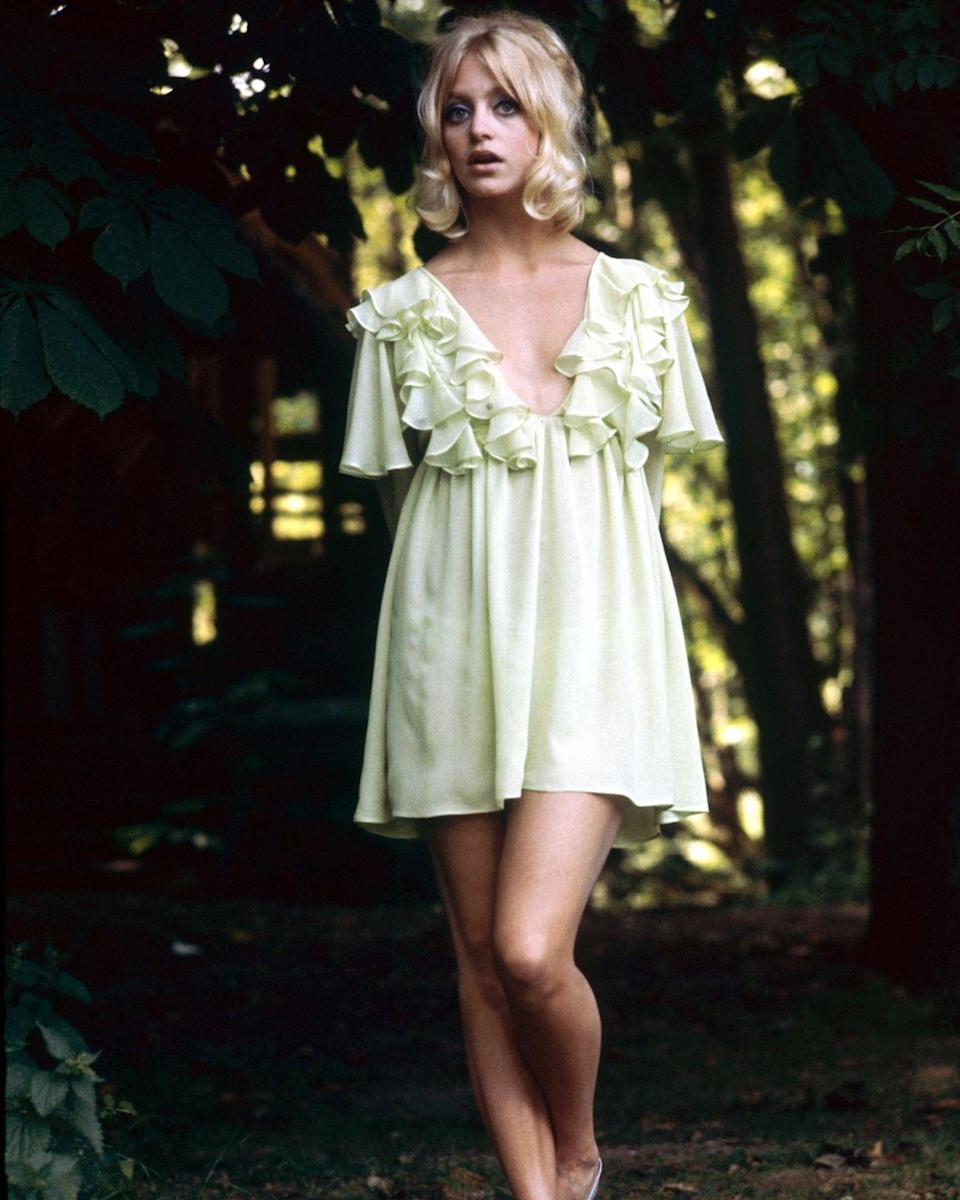<p>Preferably with ruffles and in a pastel hue, à la Goldie Hawn, so you actually look like a living doll. </p>