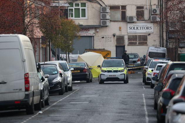 An evidence tent at the junction of Salisbury Road and Elmstead Road in Seven Kings, Ilford, east London, where three people died after being stabbed Sunday evening.