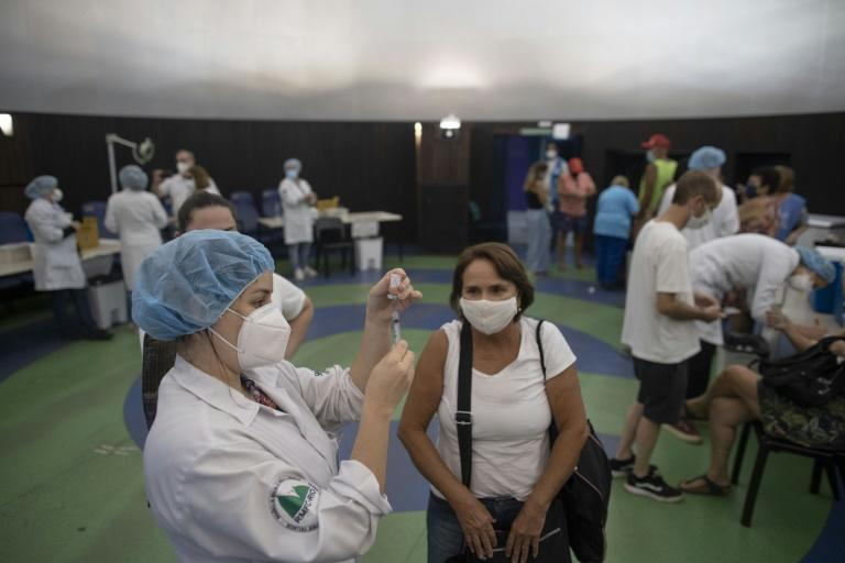 People receive coronavirus vaccines at the Public Planetarium in Rio de Janeiro, in March 2021