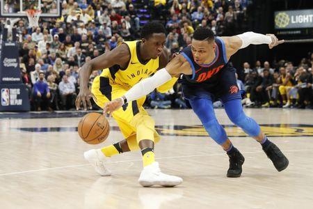 Dec 13, 2017; Indianapolis, IN, USA; Oklahoma City Thunder guard Russell Westbrook (0) knocks the ball away from Indiana Pacers guard Victor Oladipo (4) during the 4th quarter at Bankers Life Fieldhouse. Brian Spurlock-USA TODAY Sports
