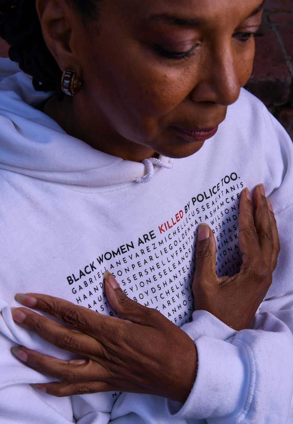 Kimberlé Crenshaw, Co-Founder and Executive Director of the African American Policy Forum wears a hoodie with the names of Black daughters, sisters, wives, cousins, and community members killed by police.