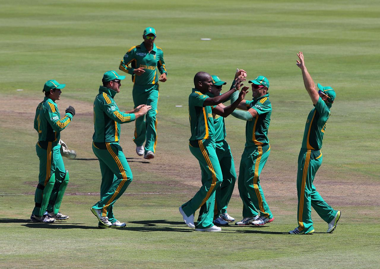 PAARL, SOUTH AFRICA - JANUARY 19: Lonwabo Tsotsobe (C) of South Africa celebrates a wicket during the 1st One Day International match between South Africa and New Zealand at Boland Park on January 19, 2013 in Paarl, South Africa.  (Photo by Carl Fourie/Gallo Images/Getty Images)