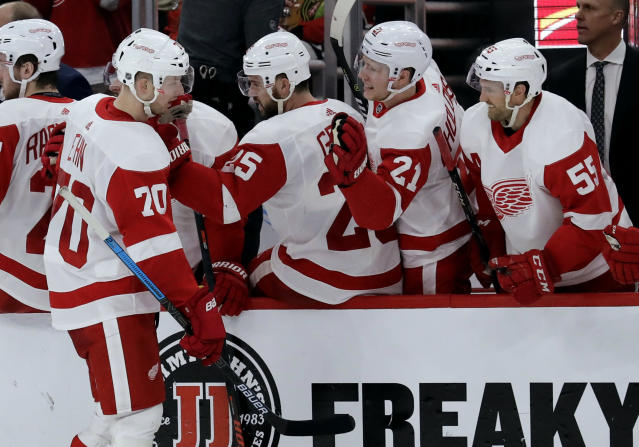 Detroit Red Wings center Christoffer Ehn (70) celebrates with teammates after scoring a goal against the Chicago Blackhawks during the second period of an NHL hockey game Sunday, Feb. 10, 2019, in Chicago. (AP Photo/Nam Y. Huh)