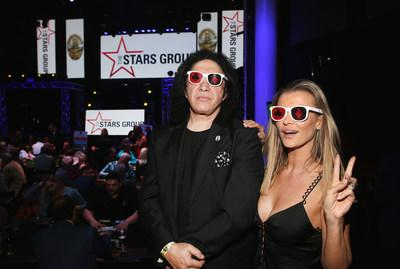 Rock Icon Gene Simmons and supermodel Joanna Krupa took a break from competing at the poker table at the 2018 LAPMF Heroes for Heroes Celebrity Poker Tournament.