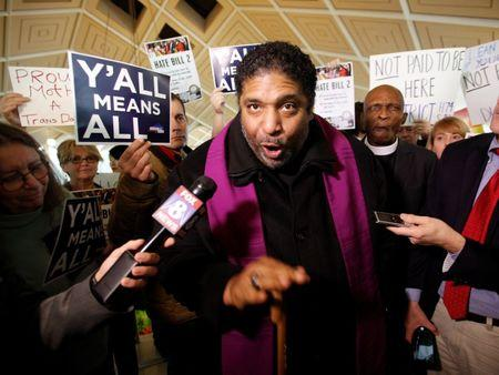 Civil rights leader Reverend William Barber, president of the NAACP in North Carolina, speaks to the media inside the state's Legislative Building as lawmakers gather to consider repealing the controversial HB2 law limiting bathroom access for transgender people in Raleigh, North Carolina, U.S. on December 21, 2016. REUTERS/Jonathan Drake