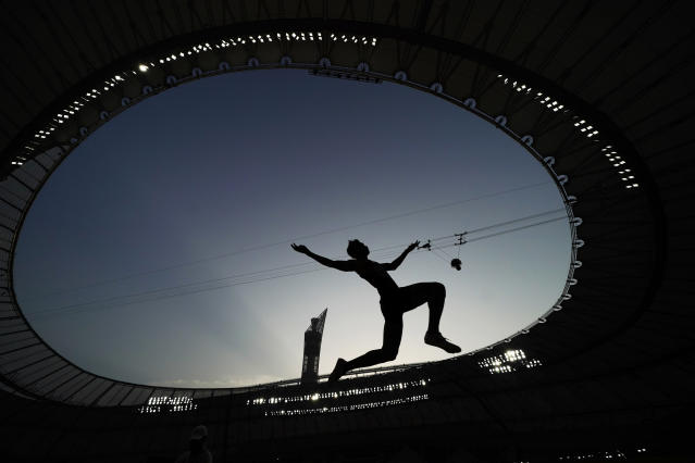 FILE - In this Sept. 27, 2019, file photo, an athlete competes during the qualifications for the men's long jump event at the World Athletics Championships in Doha, Qatar. The photo was part of a series of images by photographer David J. Phillip which won the Thomas V. diLustro best portfolio award for 2019 given out by the Associated Press Sports Editors during their annual winter meeting in St. Petersburg, Fla. (AP Photo/David J. Phillip, File)
