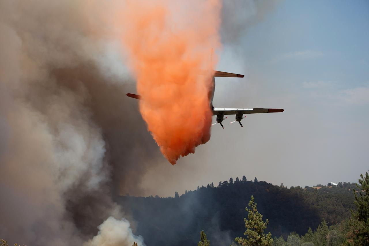 "An air tanker drops retardant on the fast-moving wildfire called ""Sand Fire"" near Plymouth, California July 26, 2014. The fire, which started Friday, has burned 5 homes, 1300 acres, and is 20 percent contained, local media reported. REUTERS/Max Whittaker (UNITED STATES - Tags: DISASTER)"