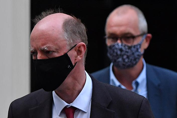 Britain's Chief Medical Officer for England Chris Whitty (L) and Britain's Chief Scientific Adviser Patrick Vallance, both wearing face coverings due to the COVID-19 pandemic, leave from 11 Downing Street in central London on September 21, 2020. - The UK government on Monday upgraded its coronavirus alert level, as its senior scientific advisor warned that England was on track for about 50,000 coronavirus cases a day by mid-October and a surging death toll unless action is taken immediately. (Photo by Ben STANSALL / AFP) (Photo by BEN STANSALL/AFP via Getty Images)