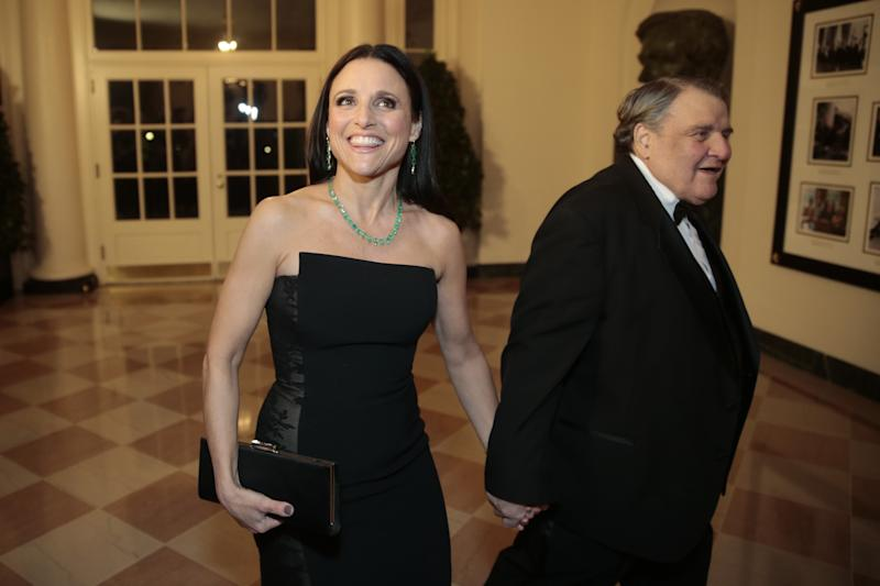 WASHINGTON, DC - FEBRUARY 11: Actress Julia Louis-Dreyfus, left, and William Louis-Dreyfus arrive to a state dinner hosted by U.S. President Barack Obama and U.S. first lady Michelle Obama in honor of French President Francois Hollande at the White House on February 11, 2014 in Washington, DC. Obama and Hollande said the U.S. and France are embarking on a new, elevated level of cooperation as they confront global security threats in Syria and Iran, deal with climate change and expand economic cooperation. (Photo by Andrew Harrer-Pool/Getty Images)