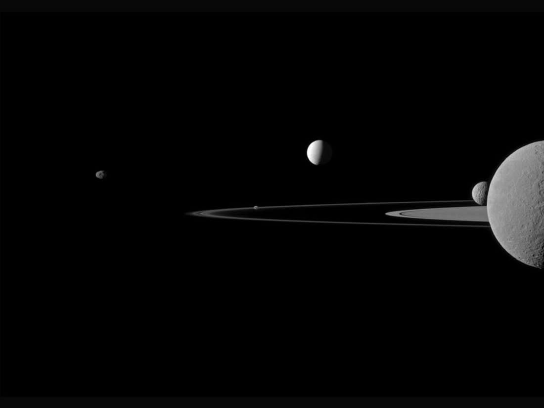 A quintet of Saturn's moons come together in the Cassini spacecraft's field of view for this July 29, 2011 portrait, in this handout image received by Reuters September 22, 2011. Janus (179 km, or 111 miles across) is on the far left. Pandora (81 km, or 50 miles across) orbits between the A ring and the thin F ring near the middle of the image. Brightly reflective Enceladus (504 km, or 313 miles across) appears above the center of the image. Saturn's second largest moon, Rhea (1,528 km, or 949 miles across), is bisected by the right edge of the image. The smaller moon Mimas (396 km, or 246 miles across) can be seen beyond Rhea also on the right side of the image. REUTERS/NASA/JPL-Caltech/Space Science Institute/Handout