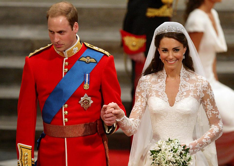 Britain's Prince William holds the hand of his wife Kate, Duchess of Cambridge as they leave Westminster Abbey after their wedding service, on April 29, 2011 in London.  AFP PHOTO/ POOL/Dave Thompson (Photo credit should read Dave Thompson/AFP via Getty Images)