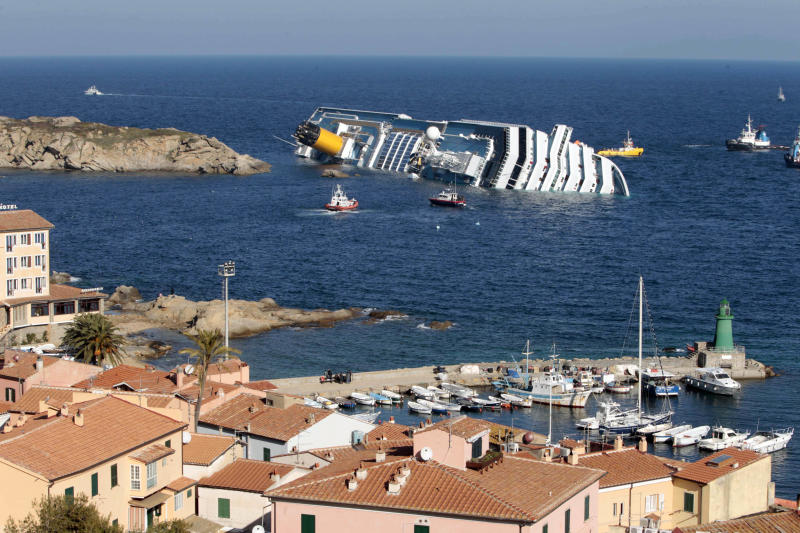 FILE - This Jan. 14, 2012 file photo shows the luxury cruise ship Costa Concordia leaning on its starboard side after running aground on the tiny Tuscan island of Giglio, Italy. Cruise operators, like airline pilots, may be relying too heavily on electronics to navigate massive ships, losing the knowledge and ability needed to operate a vessel in the case of a power failure, an expert sea pilot told a federal agency on Wednesday, March 26, 2014 (AP Photo/Gregorio Borgia, File)