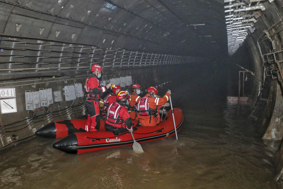 This photo taken on July 26, 2021 shows rescuers searching inside the subway which was flooded following heavy rains in Zhengzhou, in China's central Henan province. - China OUT (Photo by STR / AFP) / China OUT (Photo by STR/AFP via Getty Images)