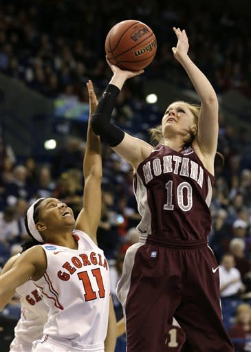 Montana's Kenzie De Boer (10) shoots over Georgia's Tiaria Griffin in the first half during a first-round game in the women's NCAA college basketball tournament in Spokane, Wash., Saturday, March 23, 2013. (AP Photo/Elaine Thompson)