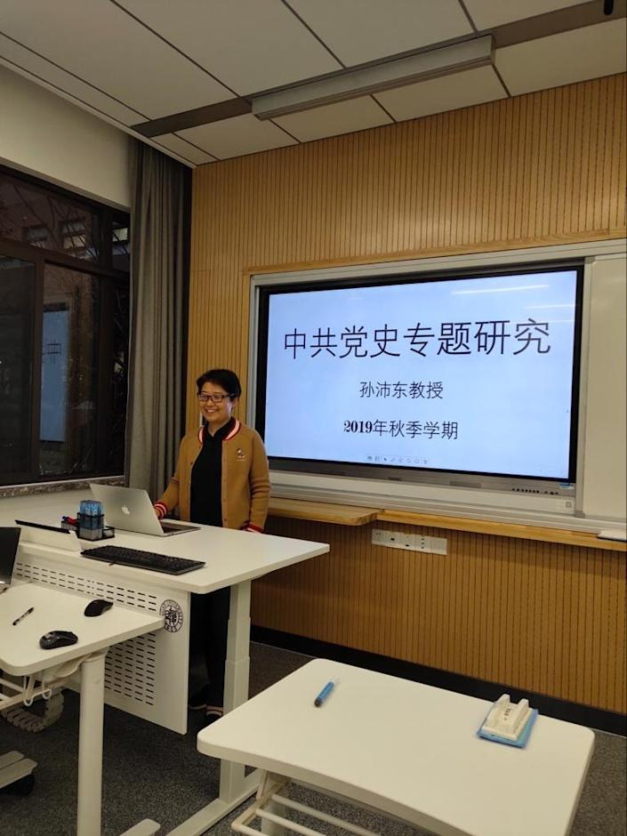 Sun Peidong stands in front of a classroom at Fudan University in December 2019.