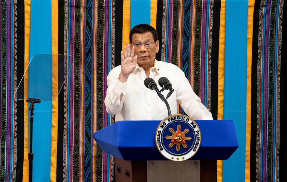 Philippine President Rodrigo Duterte gestures as he delivers his state of the nation address at Congress in Manila on July 22, 2019.  (Photo by Noel CELIS / AFP)        (Photo credit should read NOEL CELIS/AFP via Getty Images)