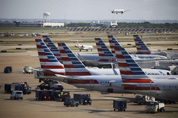 PHOTO: American Airlines Group Inc. airplanes stand at passenger gates at Dallas/Fort Worth International Airport (DFW) near Dallas, Texas, on Oct. 1, 2020. (Bloomberg via Getty Images, FILE)