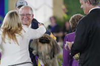 Competitors congratulate David Fitzpatrick, second from left, owner, breeder and handler of Wasabi, a Pekingese, who won Best in Show at the Westminster Kennel Club dog show, Sunday, June 13, 2021, in Tarrytown, N.Y. (AP Photo/Kathy Willens)