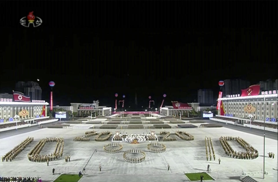 In this image made from video broadcasted by North Korea's KRT on Saturday, Oct. 10, 2020, a military parade is held in Pyongyang, North Korea. North Korea has held a massive military parade and public rally to celebrate the 75th anniversary of the country's ruling party.(KRT via AP)