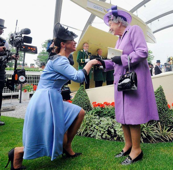 PHOTO: Queen Elizabeth II is congratulated by Princess Haya bint Hussein on Ladies' Day during day three of Royal Ascot at Ascot Racecourse on June 20, 2013, in Ascot, England. (Charlie Crowhurst/Getty Images, FILE)