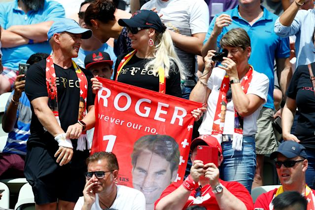 Tennis - ATP 250 - Stuttgart Open - Tennis Club Weissenhof, Stuttgart, Germany - June 17, 2018 Fans display a banner of Roger Federer during the final between Switzerland's Roger Federer and Canada's Milos Raonic REUTERS/Ralph Orlowski