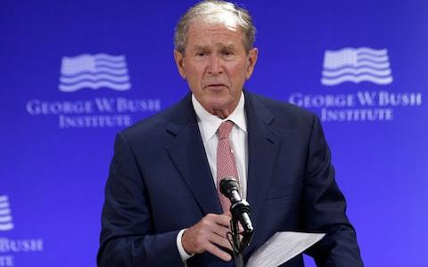 """Donald Trump criticised George W Bush, saying the Iraq invasion """"the single worst decision ever made"""" - Credit: AP"""