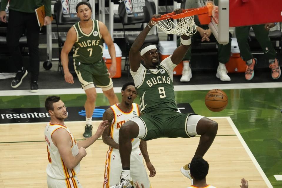 Milwaukee Bucks' Bobby Portis dunks during the first half of Game 1 of the NBA Eastern Conference basketball finals game against the Atlanta Hawks Wednesday, June 23, 2021, in Milwaukee. (AP Photo/Morry Gash)