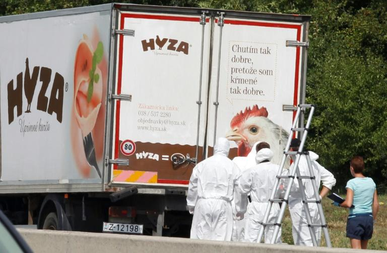 In this file photo taken on August 27, 2015 forensic investigators work on a refrigerated truck parked along a highway near Neusiedl am See, Austria, after the bodies of 71 migrants where found suffocated in the lorry. The four main suspects involved in the gruesome deaths of 71 migrants in a truck on in 2015 were sentenced to 25 years in jail on June 14, 2018, in a case that sparked international revulsion. The trial took place in Kecskemét, Hungary, which took over the proceedings from Vienna after it emerged that the migrants had suffocated in Hungary
