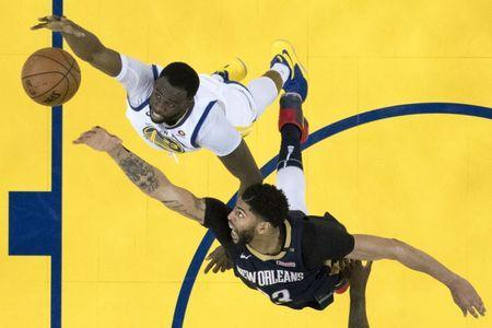 May 8, 2018; Oakland, CA, USA; Golden State Warriors forward Draymond Green (23) and New Orleans Pelicans forward Anthony Davis (23) fight for a rebound during the second half in game five of the second round of the 2018 NBA Playoffs at Oracle Arena. The Warriors defeated the Pelicans 113-104. Mandatory Credit: Kyle Terada-USA TODAY Sports