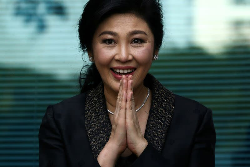 FILE PHOTO: Former Thai prime minister Yingluck Shinawatra greets supporters as she arrives at the Supreme Court in Bangkok