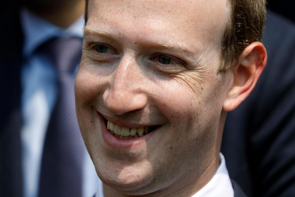 """FILE - In this May 23, 2018 file phpoto, Facebook's CEO Mark Zuckerberg smiles during a picture with guests attending the """"Tech for Good"""" Summit at the Elysee Palace in Paris. Zuckerberg's latest attempt to explain Facebook's data-sharing practices is notable for its omissions as well as what it plays up and plays down. In a Wall Street Journal op-ed Thursday, Jan. 24, 2019, titled """"The Facts About Facebook,"""" the CEO doubles down on previous talking points while leaving out, for example, a Federal Trade Commission investigation over its privacy practices.  (Charles Platiau/Pool Photo via AP, File)"""