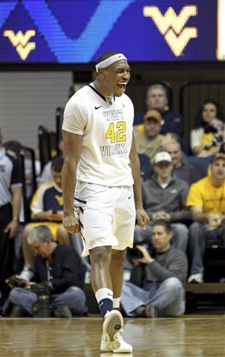 West Virginia's Kevin Jones (42) celebrates near the end of the second half of an NCAA college basketball game against West Virginia in Morgantown, W.Va., on Saturday, Jan. 7, 2012. West Virginia won 74-62. (AP Photo/David Smith)