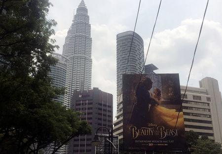 FILE PHOTO: A Beauty and the Beast poster in downtown Kuala Lumpur, Malaysia March 14, 2017. REUTERS/Angie Teo