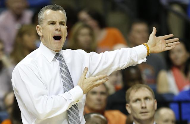 Florida head coach Billy Donovan, speaks to his players against UCLA during the first half in a regional semifinal game at the NCAA college basketball tournament, Thursday, March 27, 2014, in Memphis, Tenn. (AP Photo/John Bazemore)
