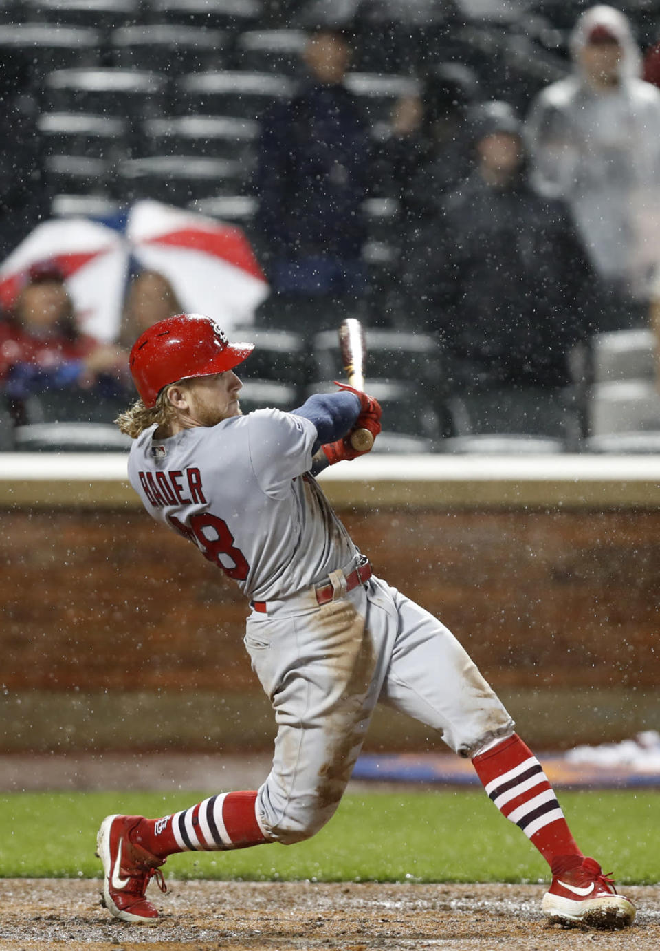 St. Louis Cardinals' Harrison Bader follows through on a ninth inning RBI double against the New York Mets in a baseball game Thursday, June 13, 2019, in New York. (AP Photo/Kathy Willens)