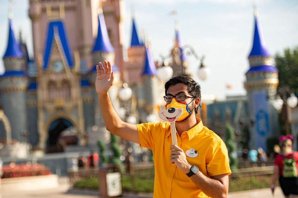 Disney cast member welcomes guests to Magic Kingdom