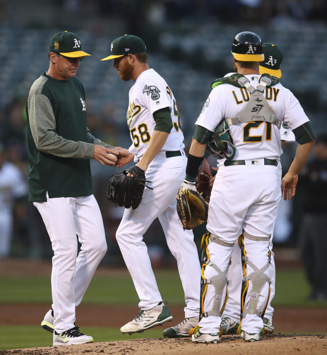 Oakland Athletics pitcher Paul Blackburn (58) hands the ball to manager Bob Melvin as he is removed during the second inning of the team's baseball game against the against the Houston Astros on Wednesday, June 13, 2018, in Oakland, Calif. (AP Photo/Ben Margot)