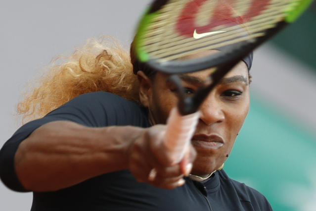 Serena Williams of the U.S. plays a shot against Japan's Kurumi Nara during their second round match of the French Open tennis tournament at the Roland Garros stadium in Paris, Thursday, May 30, 2019. (AP Photo/Pavel Golovkin)