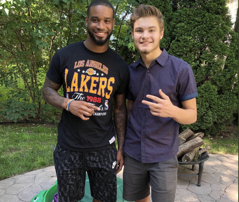 Detroit Lions cornerback Darius Slay, left, accepted Kam Register's invitation to come to his graduation party. (Kam Register/Twitter)