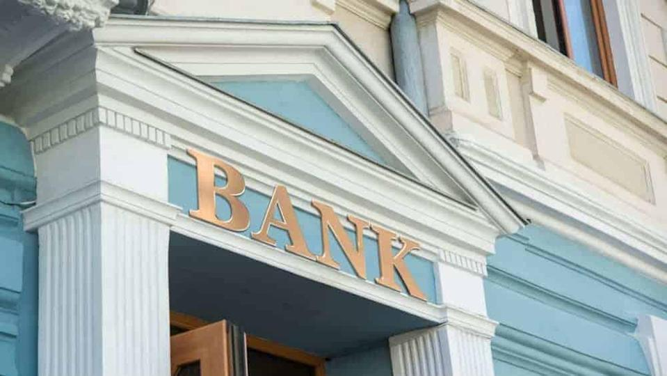 Bank sign on traditional europe building facade