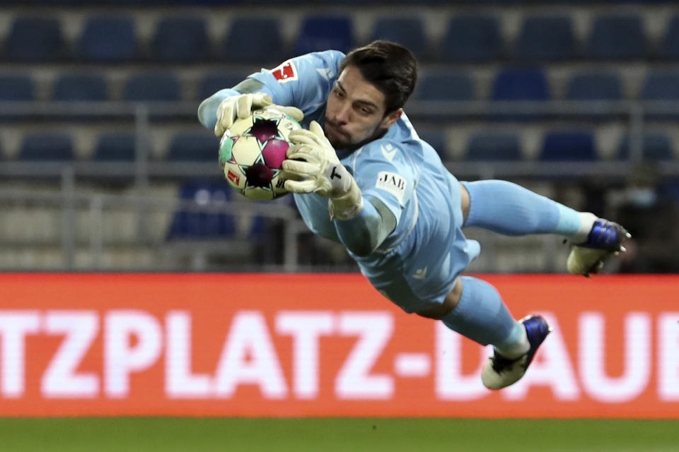 Bielefeld's goalkeeper Stefan Ortega makes a save from a Union shot on goal during their German Bundesliga soccer match at Sch'co Arena in Bielefeld, Germany, Sunday March 7, 2021. (Friso Gentsch/dpa via AP)