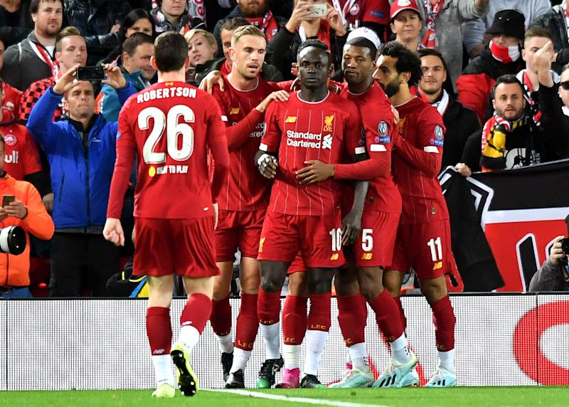 Liverpool's Sadio Mane celebrates his sides first goal of the game with teammates