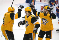 Pittsburgh Penguins' Frederick Gaudreau (11) celebrates his goal with Cody Ceci, left, and Jason Zucker during the first period of Game 1 of an NHL hockey Stanley Cup first-round playoff series against the New York Islanders in Pittsburgh, Sunday, May 16, 2021. (AP Photo/Gene J. Puskar)