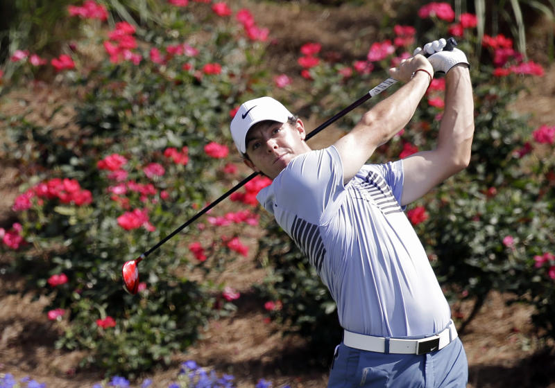 Rory McIlroy, of Northern Ireland, hits a shot from the 18th tee during a practice round for The Players championship golf tournament at TPC Sawgrass in Ponte Vedra Beach, Fla., Wednesday, May 7, 2014. (AP Photo/John Raoux)