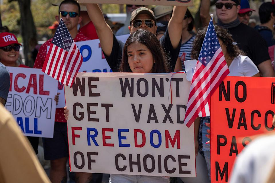 Anti-vaccination protesters rally in Los Angeles near City Hall in August in opposition to the City Council vote to introduce an ordinance to require proof of vaccination to enter many public indoor spaces.