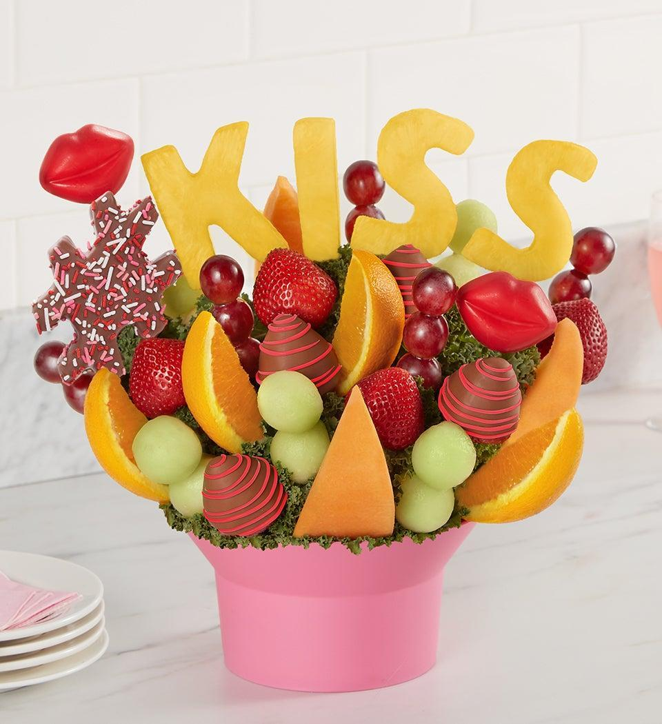 """<strong><h3>Lip Smackers Bouquet</h3></strong><br>Skip the sunflowers or daisies and go with a fresh arrangement of vibrant melon, orange wedge, chocolate-dipped strawberry, and pineapple blooms instead.<br><br><strong>Fruit Bouquets</strong> Berry Cute, $, available at <a href=""""https://go.skimresources.com/?id=30283X879131&url=https%3A%2F%2Fwww.fruitbouquets.com%2Flip-smackers-bouquet-179076"""" rel=""""nofollow noopener"""" target=""""_blank"""" data-ylk=""""slk:Fruit Bouquets"""" class=""""link rapid-noclick-resp"""">Fruit Bouquets</a>"""