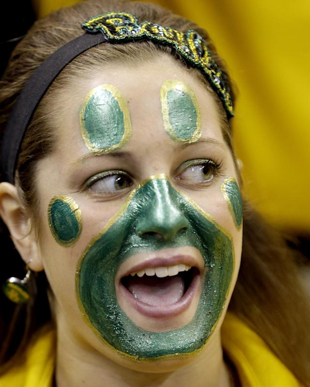 Baylor band member Shannon Blankenberker cheers as the team takes the court for a second-round game in the NCAA college basketball tournament against Nebraska Friday, March 21, 2014, in San Antonio. (AP Photo/David J. Phillip)
