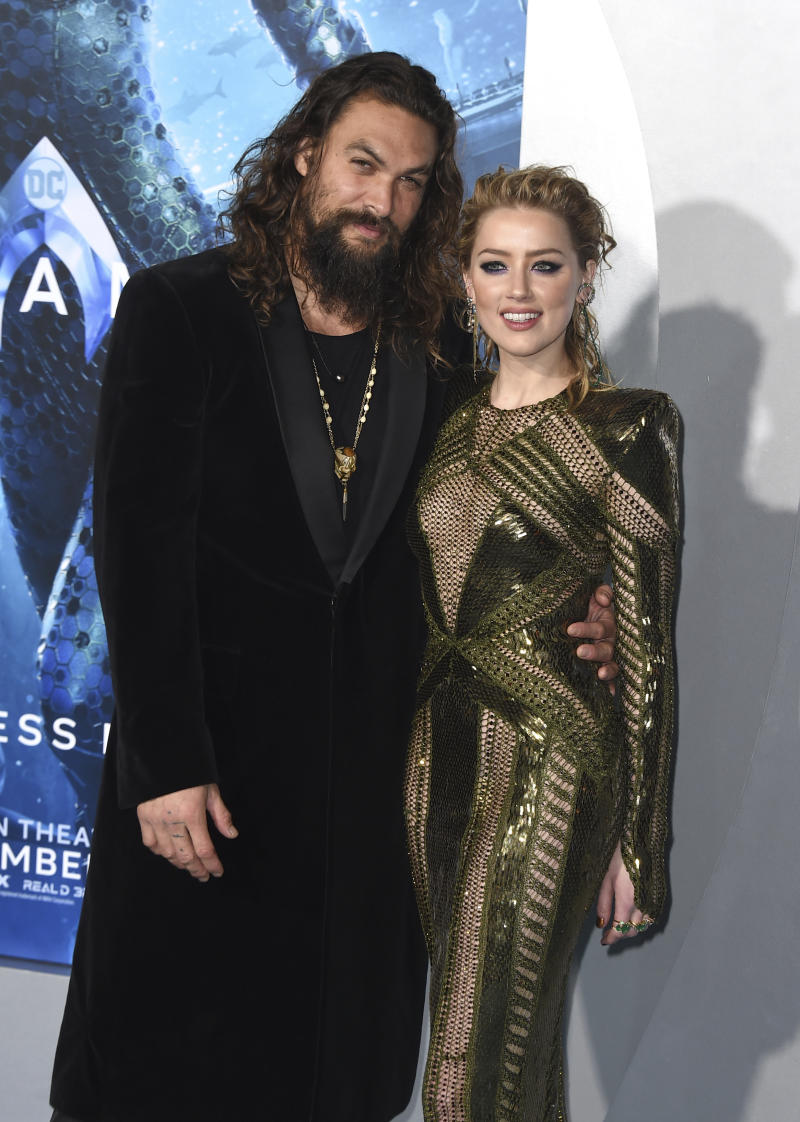 "Jason Momoa, left, and Amber Heard arrive at the premiere of ""Aquaman"" at TCL Chinese Theatre on Wednesday, Dec. 12, 2018, in Los Angeles. (Photo by Jordan Strauss/Invision/AP)"
