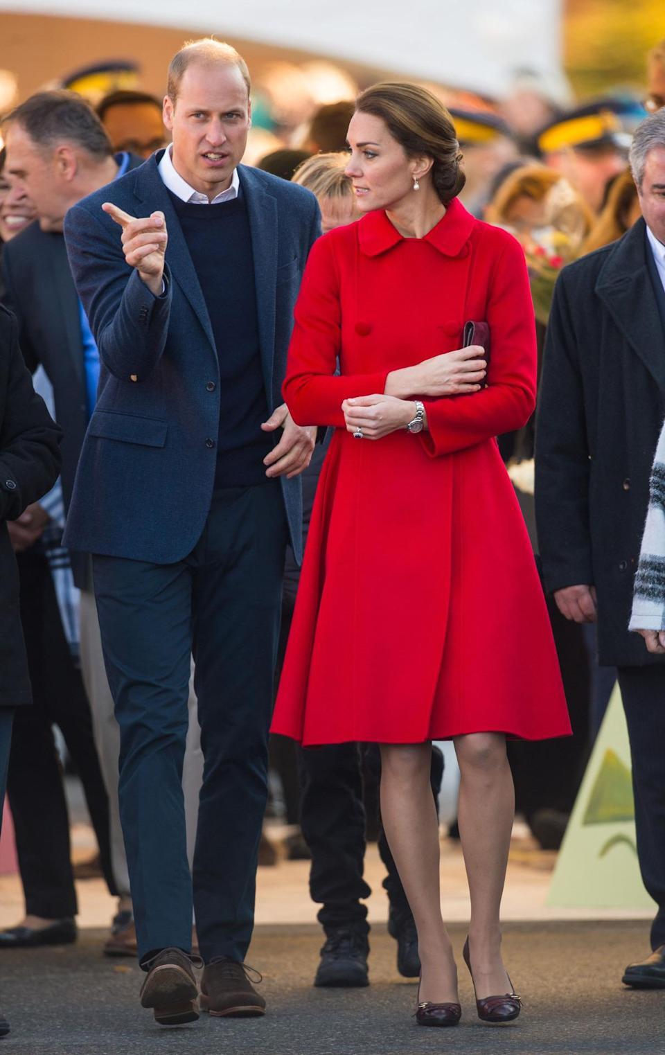 <p>The royal couple spent a day in Yukon, Canada with Kate wearing a bright red coat by Carolina Herrera. The coat is new season but isn't yet available online so keep your eyes peeled. Fringed leather pumps from Tod's and a suede Mulberry clutch finished off the ensemble.</p><p><i>[Photo: PA]</i> </p>