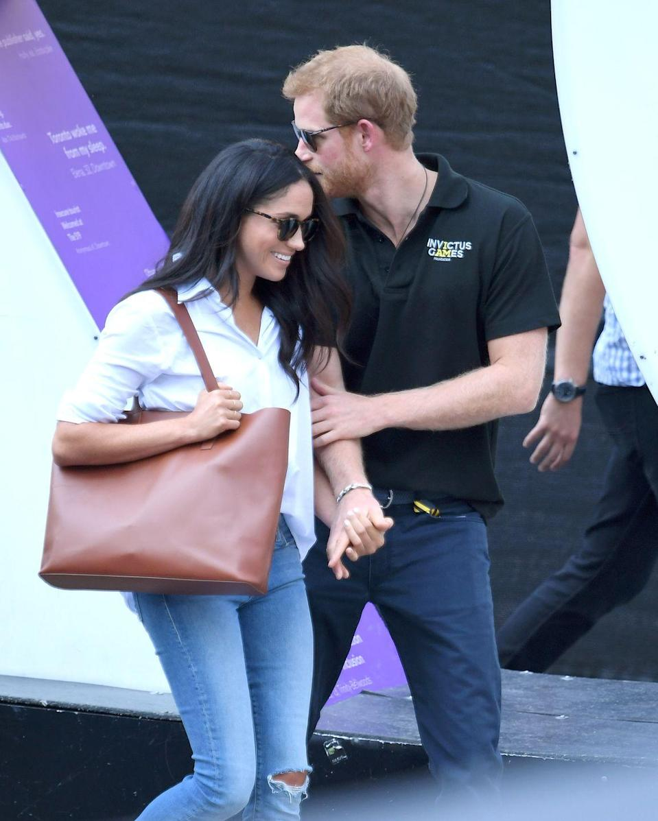 <p>Prince Harry and Meghan Markle couldn't keep their hands off each other as they attended a sporting event on day three of the Invictus Games Toronto 2017 in September. </p>